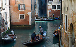 Venice-Italy - March 27, 2010 -- gondola / gondoliers with passengers / tourists in a narrow, small canal -- infrastructure, transport, water, tourism -- Photo: © HorstWagner.eu