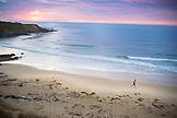 NEW ZEALAND, Oamaru, Running on the Beach at sunrise, Ben M Thomas