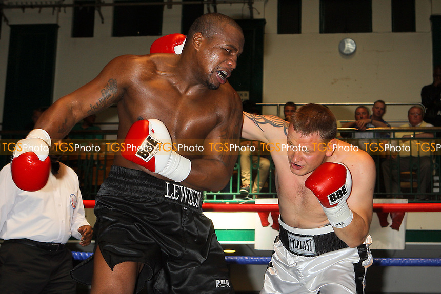 Ian Lewinson (black shorts) defeats Igoris Borucha in a Heavyweight boxing contest at York Hall, Bethnal Green, pormoted by Left Jab / Miranda Carter - 20/06/10 - MANDATORY CREDIT: Gavin Ellis/TGSPHOTO - Self billing applies where appropriate - Tel: 0845 094 6026