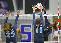 NWA Democrat-Gazette/ANDY SHUPE<br /> Fayetteville's Rosana Hicks (5) sends the ball past Har-Ber's Mackenzie White (11) and Halle Roberts (25) Wednesday, Sept. 13, 2017, during play in Bulldog Arena. Visit nwadg.com/photos to see more photographs from the match.