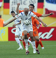Serbia & Montenegro's Predrag Djordjevic (11) and Netherland's Mark Van Bommel (18) battle for the ball during a World Cup Group B game at Zentralstadion, Leipzig, Germany, Sunday, June 11, 2006. The Netherlands defeated Serbia and Montenegro 1-0.