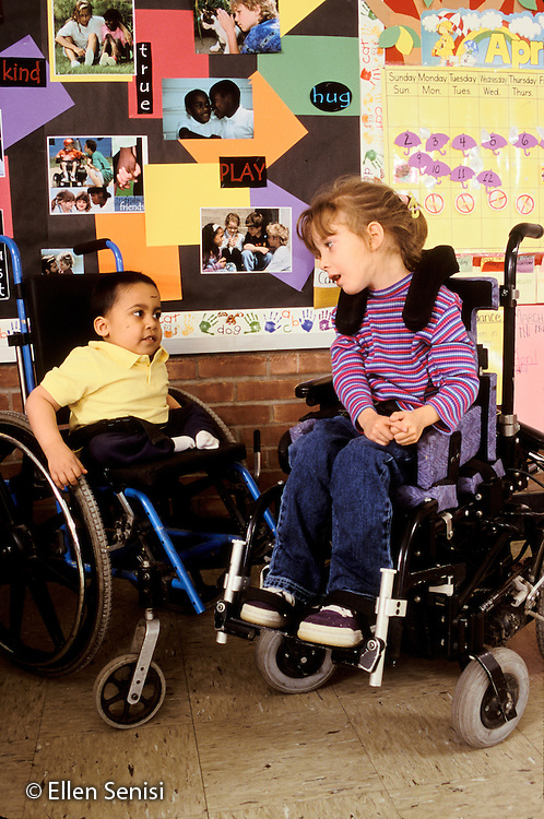 MR / Schenectady, NY.Zoller Public School / Grade 1 Inclusion Class.Friends talk. (Girl: 6, cerebral palsy; Boy: 7, spina bifida, sacral agenesis, Bangledeshi & Puerto-Rican-American)..MR: Rah1, Her4.PN#: 30095                      FC#: 21693-00207.scan from slide.© Ellen B. Senisi