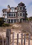 Expensive homes line the boardwalk outside the central part of town, along the southern beach leading to Dewey.  Rehoboth Beach, Delaware, USA.  © Rick Collier