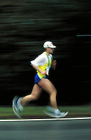 Male runner during 1 2 marathon road race, endurance, competition, racing, races, speed, motion, blurred, man, men; NR.
