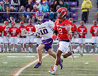 UAlbany Men's Lacrosse defeats Stony Brook on March 31 at Casey Stadium.  Wayne White (#12) defended byTroy Reh (#10).