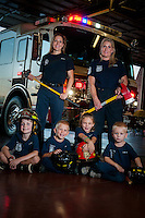 From left, Kevin Millar, Jr., 7,  Kemper Minnick, 5, and his siblings, Kyndal, 7, and Taylor, 3, with their moms, left, rear, Phoenix fire captain/paramedic, Nicole Minnick and Glendale firefighter, paramedic, Lindel Millar.