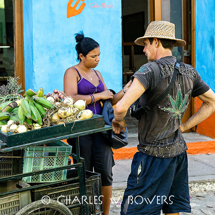 Faces Of Cuba - visiting the vegetable vendor for dinner goods.<br />
