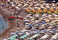 Beach crowded with umbrellas Rhodes Greece