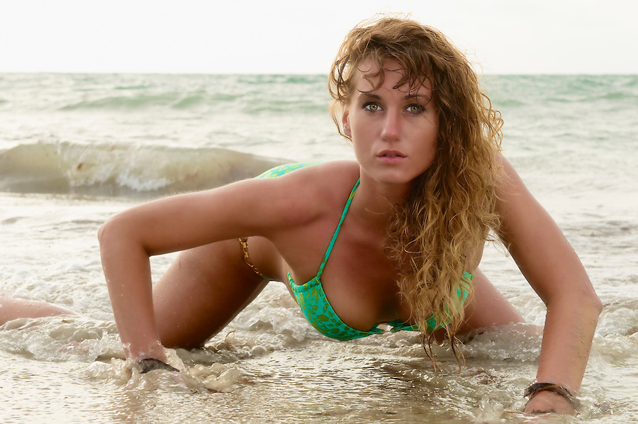 Sexy model posing in the beach early morning.