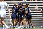 CHAPEL HILL, NC - MAY 20: Navy's Julia Collins (second from left) celebrates scoring the game's first goal with Andie O'Sullivan (30), Jenna Collins (44), Meg O'Donnell, and Kayla Harris (25). The University of North Carolina Tar Heels hosted the U.S. Naval Academy Midshipmen on May 20, 2017, at Fetzer Field in Chapel Hill, NC in an NCAA Women's Lacrosse Tournament Quarterfinal match. Navy won the game 16-14.
