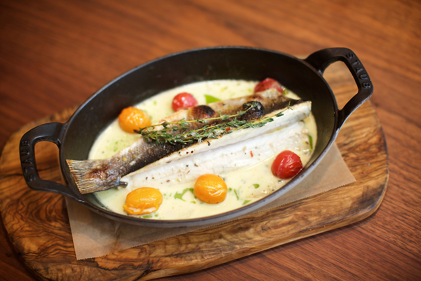 New York, NY - May 17, 2016: Branzino at Laurent Tourondel's L'Amico by chef Larry Baldwin in the Eventi Hotel in Midtown South.<br /> <br /> CREDIT: Clay Williams for Haute Life.<br /> <br /> &copy; Clay Williams / claywilliamsphoto.com