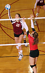 SIOUX FALLS, SD - OCTOBER 25:  Elizabeth Fiegen #12 from Roosevelt tips the ball past Larissa Trainer #24 from Rapid City Central in the third game of their match Friday night at Roosevelt. (Photo by Dave Eggen/Inertia)
