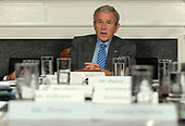 United States  President George W. Bush speaks to the media after participating in a video teleconference with Iraq Provincial Reconstruction Team Leaders and Brigade Combat Commanders in the Roosevelt Room of the White House on October 15, 2008.  <br /> Credit: Roger L. Wollenberg / Pool via CNP