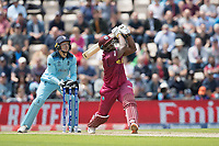 Andre Russell (West Indies) launches Adil Rashid (England) high over long on during England vs West Indies, ICC World Cup Cricket at the Hampshire Bowl on 14th June 2019