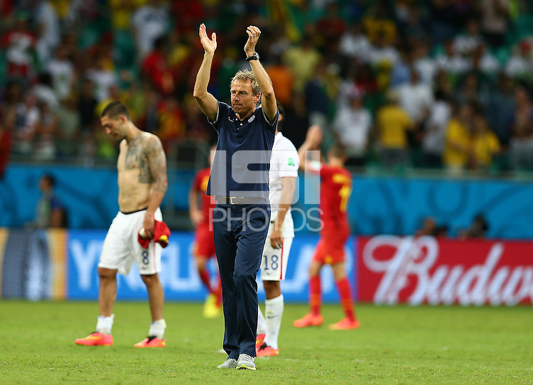 USA coach Juergen Klinsmann applauds the fans at full time following his sides elimination from the World Cup