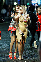 Pictured: Two young women take a selfie. Sunday 31 December 2017 and 01 January 2018<br /> Re: New Year revellers in Wind Street, Swansea, Wales, UK
