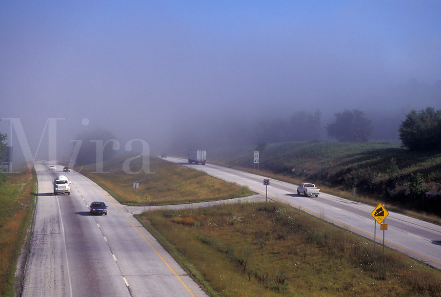 Vermont, VT, Traffic on Interstate 89 in the fog in Berlin.