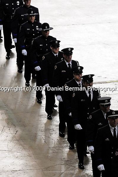 Officers march into the Tacoma Dome during a memorial service for four slain police officers in Tacoma, WA Tuesday December 8, 2009. The memorial brought an estimated 20,000 police officers and community members to the area.
