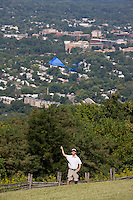 Patrons of the cultural festival enjoy the view while flying a kite from Mt Altos in onto the city of Charlottesville. Credit Image: © Andrew Shurtleff