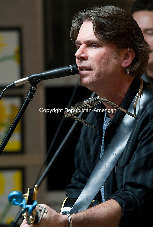 LITCHFIELD,  CT-011915JS03-  Kenn Morr, of the Kenn Morr Band, sings a song from the ban's new album &quot;Afterimage&quot; during a concert Thursday at the Oliver Wolcott Library in Litchfield. <br />  Jim Shannon Republican-American
