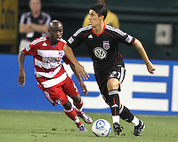 Pablo Hernandez #21 of D.C. United moves the ball away from Jair Benitez #5 of FC Dallas during an MLS match at RFK Stadium in Washington D.C. on August 14 2010. Dallas won 3-1.