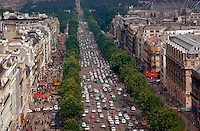 Champs Elysee at daytime with traffic, ornate buildings, and tree-lined street, Paris, France