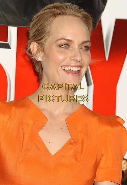 "AMBER VALLETTA.""The Spy Next Door"" Los Angeles Premiere held at The Grove, Los Angeles, California, USA, .January 9th, 2010. .headshot portrait hair up orange smiling.CAP/ADM/MJ.©Michael Jade/AdMedia/Capital Pictures."