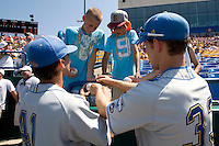 UCLA player sign autographs before Game 11 of the NCAA Division One Men's College World Series on June 25th, 2010 at Johnny Rosenblatt Stadium in Omaha, Nebraska.  (Photo by Andrew Woolley / Four Seam Images)