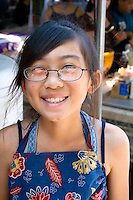 Young happy Hmong kitchen worker in outdoor restaurant age 10. Hmong Sports Festival McMurray Field St Paul Minnesota USA