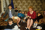 Blackhill estate Glasgow Scotland. Uk. 1980s. Single parent family. Mother and her seven children watching TV at home.