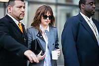 Dakota Johnson attends Day 7 of New York Fashion Week on Feb 18, 2015 (Photo by Hunter Abrams/Guest of a Guest)