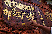 Sanskrit and Bhutanese religious inscriptions are seen on walls in Paro, Bhutan. Photo: Sanjit Das/Panos