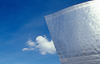 The prow-like form of Frank Gehry's Guggenheim Museum in Bilbao juts out against the blue sky