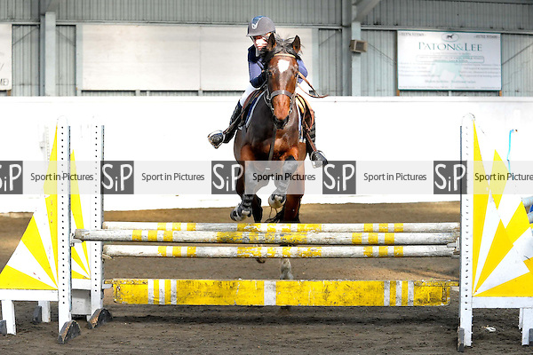Class 1. KBIS Insurance British Novice. Tuesday British Showjumping (BS) winter schedule. Norton Heath Equestrian Centre. Essex. 04/03/2014. MANDATORY Credit Ellie Ingram/Sportinpictures - NO UNAUTHORISED USE - 07837 394578