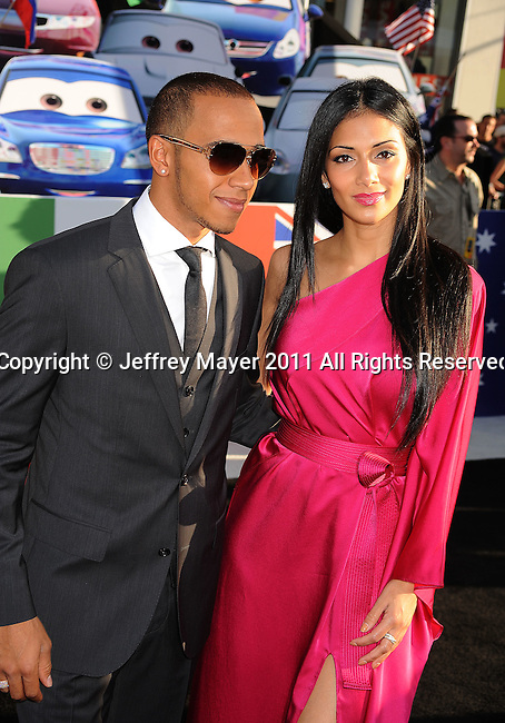 "HOLLYWOOD, CA -JUNE 18: Formula One racing driver Lewis Hamilton and singer Nicole Scherzinger attend the ""Cars 2"" Los Angeles Premiere at the El Capitan Theatre on June 18, 2011 in Hollywood, California."