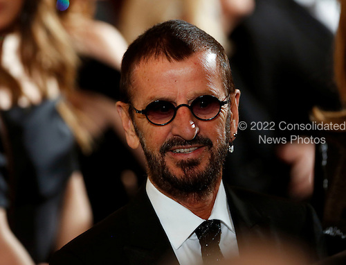 Musician and former Beatles member Ringo Starr leaves after United States President Barack Obama delivered remarks at the Kennedy Center Honors Reception in the East Room of the White House, December 4, 2016, Washington, DC.  The 2016 honorees are: Argentine pianist Martha Argerich; rock band the Eagles; screen and stage actor Al Pacino; gospel and blues singer Mavis Staples; and musician James Taylor.<br /> Credit: Aude Guerrucci / Pool via CNP