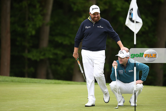 Shane Lowry (IRL) puts a tricky putt close on the 16th which ends in a bit of friendly banter with Branden Grace (RSA) during Round Three of the 2015 BMW PGA Championship over the West Course at Wentworth, Virginia Water, London. 23/05/2015. Picture David Lloyd | www.golffile.ie.
