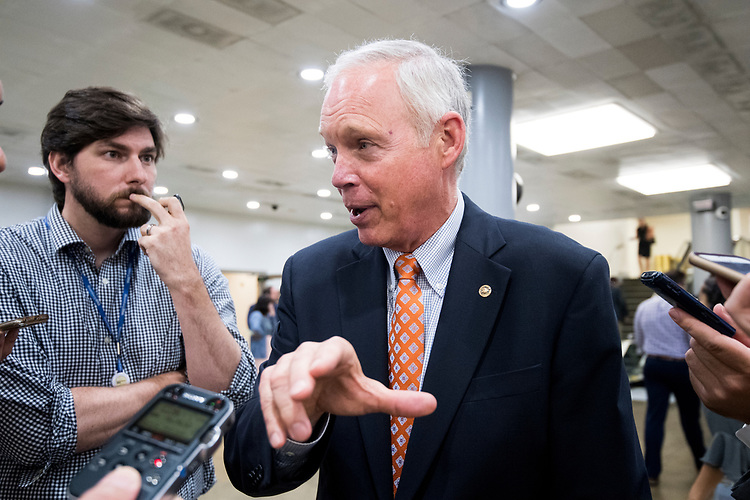 UNITED STATES - JULY 31: Sen. Ron Johnson, R-Wisc., speaks with reporters at the Senate subway in the Capitol on Tuesday, July 31, 2018. (Photo By Bill Clark/CQ Roll Call)
