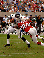 Nov. 6, 2005; Tempe, AZ, USA; Running back (37) Shaun Alexander of the Seattle Seahawks is tackled by safety (24) Adrian Wilson of the Arizona Cardinals at Sun Devil Stadium. Mandatory Credit: Mark J. Rebilas