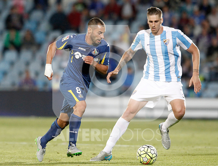Getafe's Medhi Lacen (l) and Malaga's Ricardo Horta during La Liga match.September 18,2015. (ALTERPHOTOS/Acero)