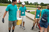 "Thomas Franco, center, talks with fellow members during ""Circle the City with Service,"" the Kiwanis Circle K International's 2015 Large Scale Service Project, on Wednesday, June 24, 2015, in Indianapolis. (Photo by James Brosher)"