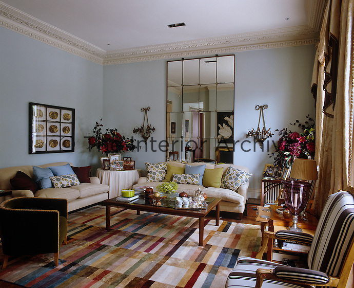 The riot of patterns and textures in this comfortable sitting room creates a contemporary style in a period building