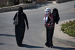 Women and a girl make their way out of Caritas Baby Hospital, in Bethlehem, West Bank.