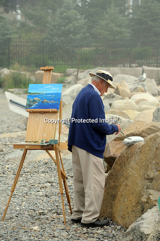 Artist at Work at the Shore in Maine, USA