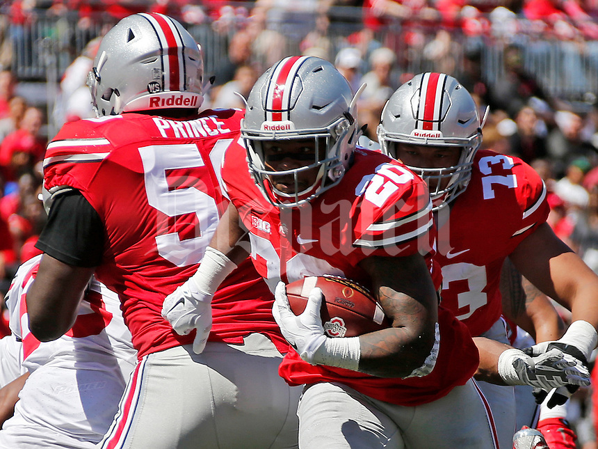 Isaiah Prince (59) and Michael Jordan (73) block for Mike Weber (20) of the Scarlet Team during the Spring Game at Ohio Stadium in Columbus on Saturday, April 16, 2016.  (Barbara J. Perenic/The Columbus Dispatch)