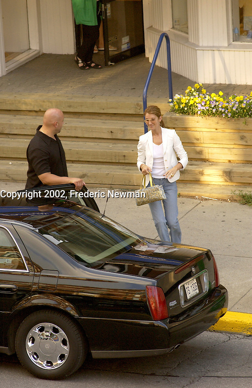 July 27  2002,Montreal, Quebec, Canada; <br /> <br /> EXCLUSIVE PHOTO <br /> A bodyguard opens the limo door for Celine Dion   outside  Jacadi, kid clothing store, on Laurier street in Montreal, July 27,  2002<br /> <br /> (Mandatory Credit: Photo by Frederic Newman - Images Distribution (&copy;) Copyright 2002 by Frederic Newman<br /> <br /> Worlwide rights (except  Canada) exclusive to Famous UK , Canada Out<br /> <br /> NOTE :  D-1 X original JPEG, saved as Adobe 1998 RGB