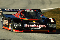 """AJ Foyt hustles his Porsche 962 through Daytona's """"bus stop"""" chicane during the Saturday morning warmup before the 1988 race. Foyt, along with co-drivers Al Unser, Jr. and  Elliott Forbes-Robinson, brought the car to the finish in 6th place."""