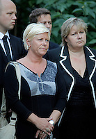 "(Oslo July 27, 2011)  Siv Jensen (Progress Party) listens with other politicians as PM Jens Stoltenberg announced the creation of a ""22 July Commission"" to investigate Friday's bomb and gun attacks...A large vehicle bomb was detonated near the offices of Norwegian Prime Minister Jens Stoltenberg on 22 July 2011. .Another terrorist attack took place shortly afterwards, where a man killed 68 people, mainly children and youths attending a political camp at Utøya island. ..Anders Behring Breivik was arrested on the island and has admitted to carrying out both attacks..(photo:Fredrik Naumann/Felix Features)"