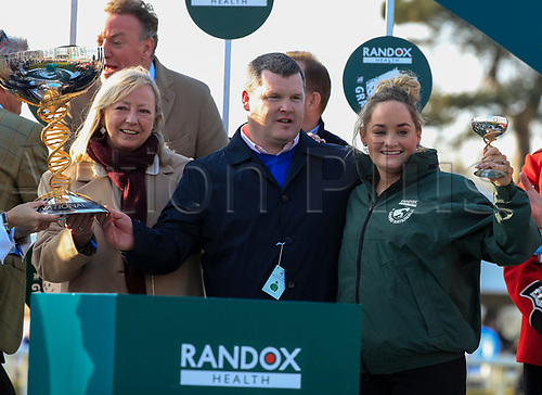 14h April 2018, Aintree Racecourse, Liverpool, England; The 2018 Grand National horse racing festival sponsored by Randox Health, day 3; Winner trainer Gordon Elliott and the stable lass celebrate winning the Grand National with their horse Tiger Roll