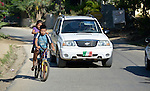 Eleven-year old Juan Lopez and his 9-year old sister Yarelly ride a bike in Zipolite, a town in Oaxaca, Mexico. Juan is blind, and yet rides his bike with his sister's help. She perches on the back and signals him which way to steer by pinching his shoulder. If she pinches his right shoulder, for example, he goes right. The harder the pinch, the sharper the turn.